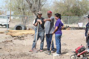 Discussing the community garden at Ysleta del Sur Pueblo. From Left: Sean Bruna, Cuco, and Deloris.